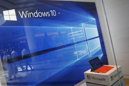 FILE PHOTO: A display for the Windows 10 operating system is seen in a store window of the Microsoft store at Roosevelt Field in Garden City, New York, U.S., July 29, 2015. REUTERS/Shannon Stapleton/File Photo