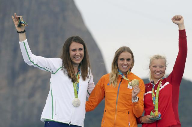 2016 Rio Olympics - Sailing - Victory Ceremony - Women's One Person Dinghy - Laser Radial - Victory Ceremony - Marina de Gloria - Rio de Janeiro, Brazil - 16/08/2016. Annalise Murphy (IRL) of Ireland, Marit Bouwmeester (NED) of Netherlands and Anne-Marie Rindom (DEN) of Denmark pose with their medals. REUTERS/Benoit Tessier FOR EDITORIAL USE ONLY. NOT FOR SALE FOR MARKETING OR ADVERTISING CAMPAIGNS.