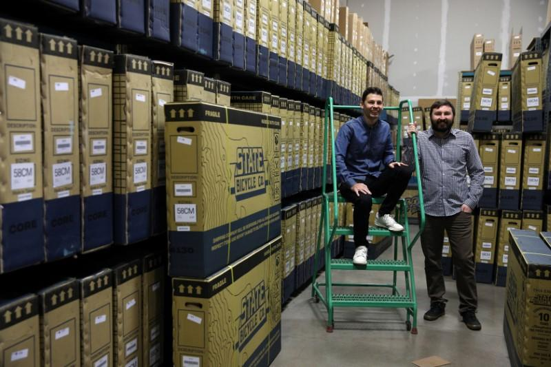 Co-founders Reza Farsi and Mehdi Farsi pose for a portrait in their warehouse at State Bicycle in Tempe
