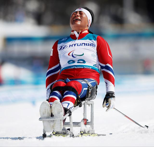 Cross-Country Skiing - Pyeongchang 2018 Winter Paralympics - Ladies' 12 KM - Sitting - Alpensia Biathlon Centre - Pyeongchang, South Korea - March 11, 2018 - Lee Do-yeon of South Korea reacts. REUTERS/Carl Recine
