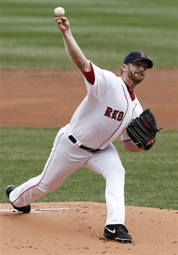 Boston Red Sox starting pitcher Ryan Dempster delivers against the Tampa Bay Rays during the first inning of a baseball game at Fenway Park in Boston Monday, April 15, 2013. (AP Photo/Winslow Townson)