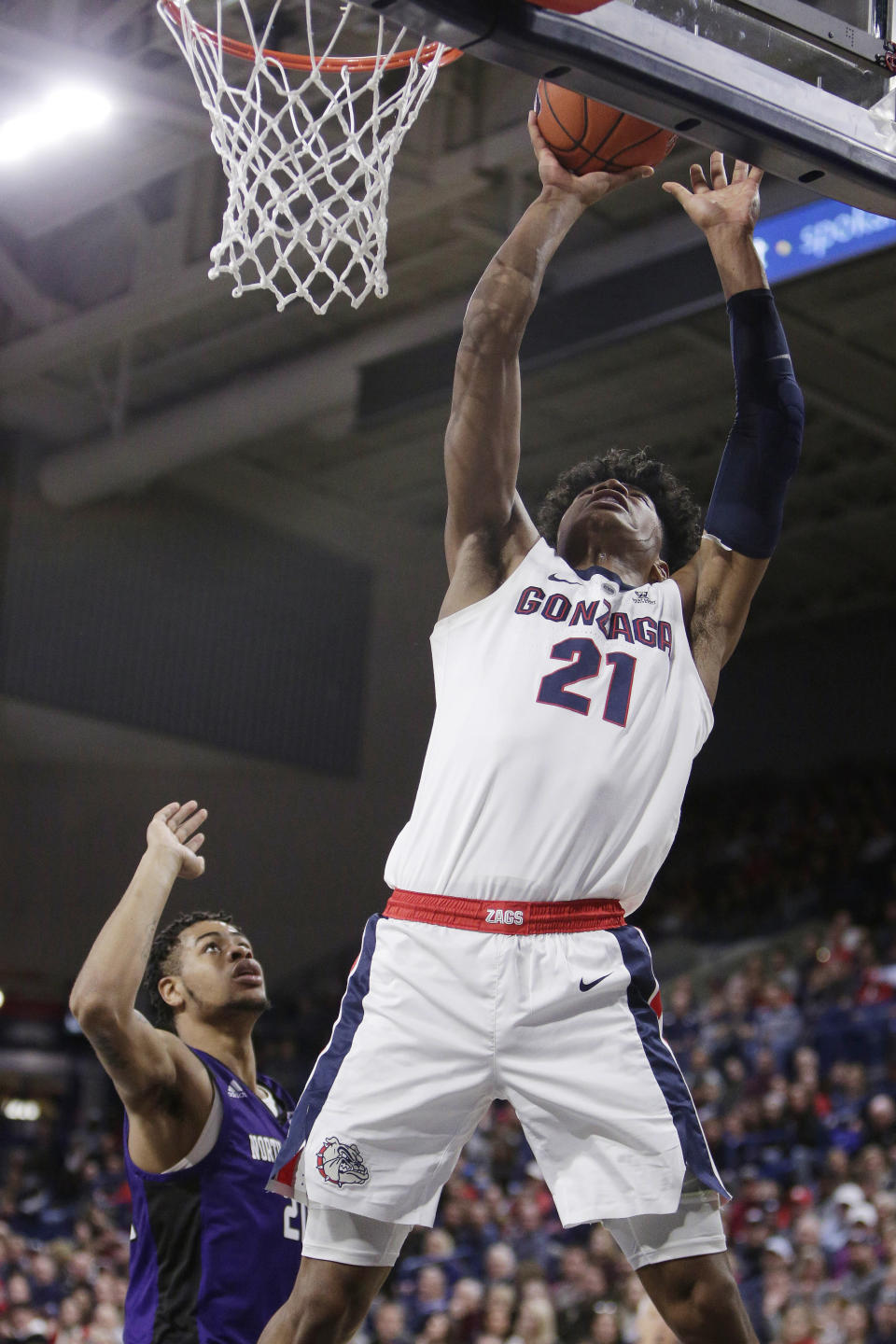 Gonzaga forward Rui Hachimura (21) shoots in front of North Alabama forward Emanuel Littles during the first half of an NCAA college basketball game in Spokane, Wash., Friday, Dec. 28, 2018. (AP Photo/Young Kwak)