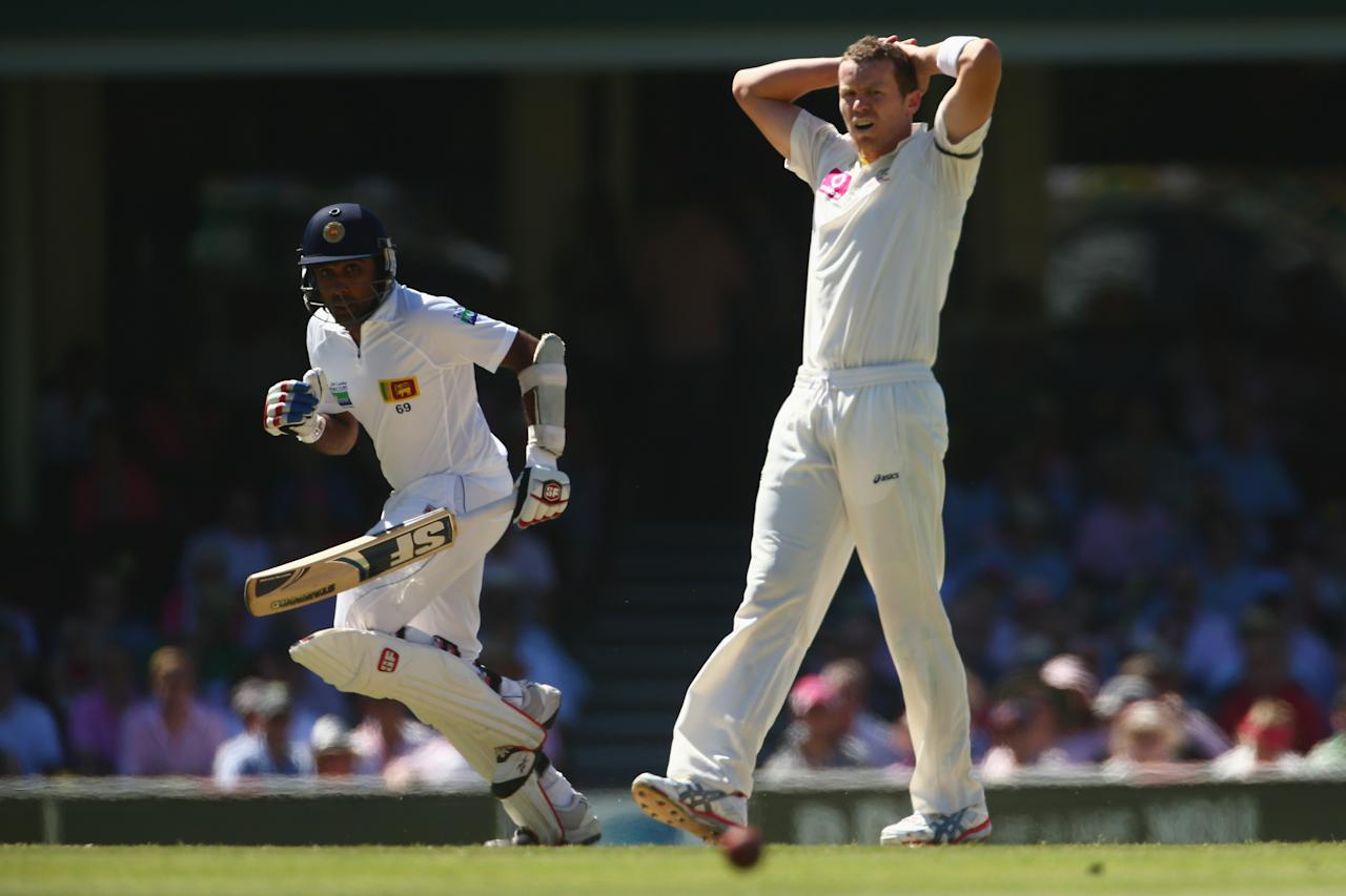 SYDNEY, AUSTRALIA - JANUARY 05:  Peter Siddle of Australia shows his frustration during day three of the Third Test match between Australia and Sri Lanka at Sydney Cricket Ground on January 5, 2013 in Sydney, Australia.  (Photo by Mark Kolbe/Getty Images)