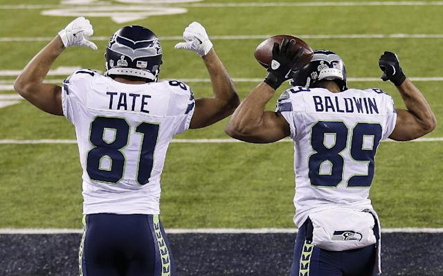 Seattle Seahawks wide receiver Golden Tate (81) and wide receiver Doug Baldwin (89) pump their arms in celebration after a touchdown run by Baldwin during the second half of the NFL Super Bowl XLVIII football game against the Denver Broncos Sunday, Feb. 2, 2014, in East Rutherford, N.J. (AP Photo/Gregory Bull)
