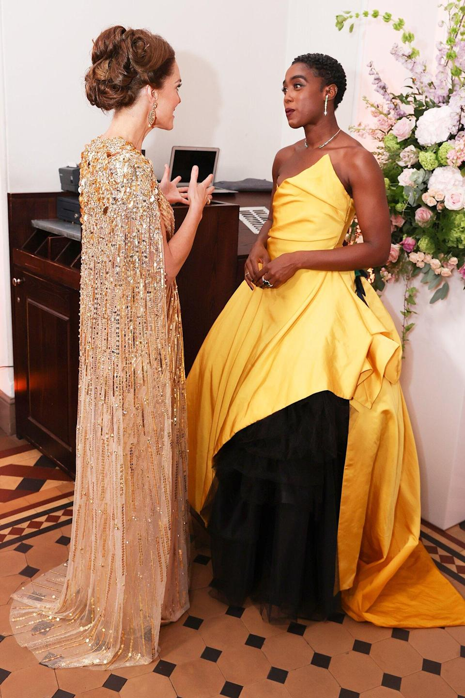 """Catherine, Duchess of Cambridge meets some of the cast including Lashana Lynch at the """"No Time To Die"""" World Premiere at Royal Albert Hall on September 28, 2021 in London, England."""