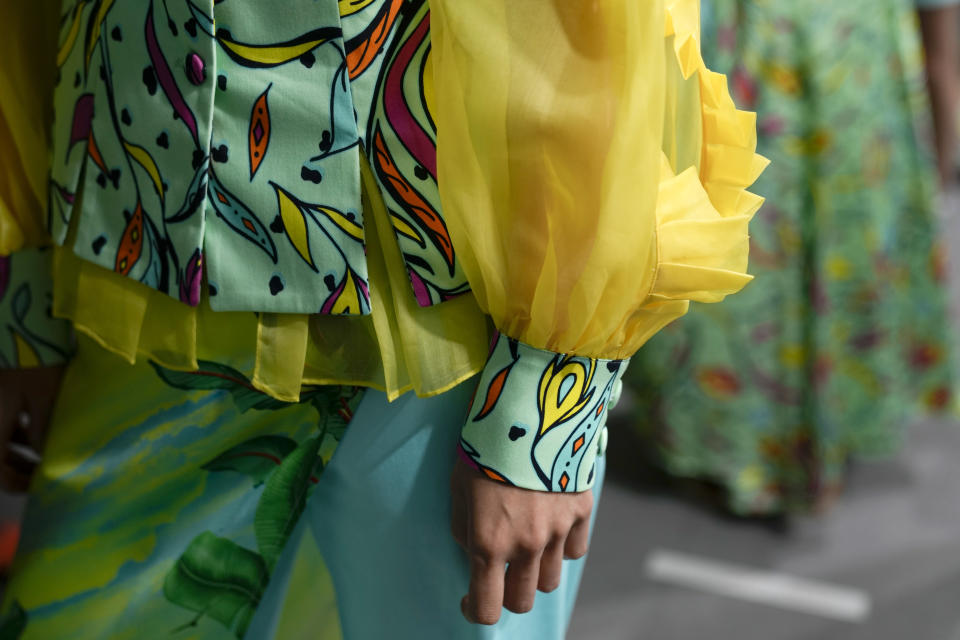 A model wears a creation of Joy Meribe's Spring Summer 2022 collection in the backstage of the Milan Fashion Week, in Milan, Italy, Wednesday, Sept. 22, 2021. (AP Photo/Luca Bruno)