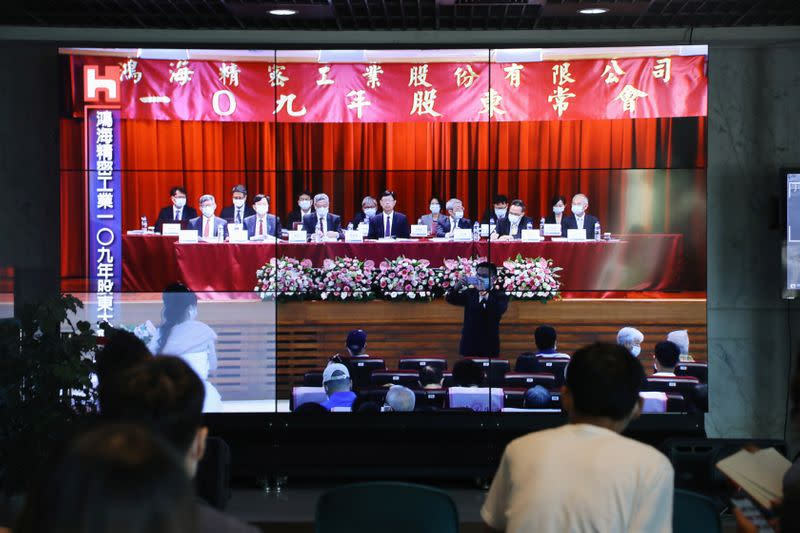 Members of the media listen to the annual general meeting at Foxconn in Taipei,