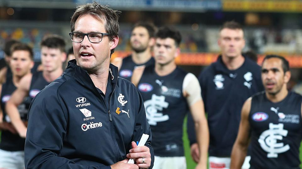 Pictured here, Carlton coach David Teague addresses his Blues players.