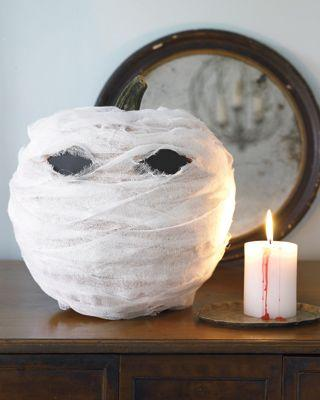 "<p>Want to decorate your home with pumpkins but don't want pull out the knives to carve them? Grab cheese cloth and wrap it around your pumpkins, and you should be good to go.</p><p><em><a href=""https://www.womansday.com/home/crafts-projects/how-to/a5999/craft-project-menacing-mummy-123881/"" target=""_blank"">Get the tutorial for Menacing Mummy.</a></em></p>"