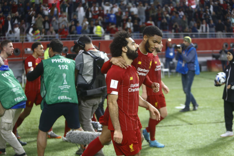 Liverpool's players celebrate after a goal during the Club World Cup semifinal soccer match between Liverpool and Monterrey at the Khalifa International Stadium in Doha, Qatar, Wednesday, Dec. 18, 2019. (AP Photo/Hussein Sayed)