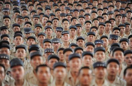 Inmates listen to a speech at Taiyuan No.1 prison in Taiyuan