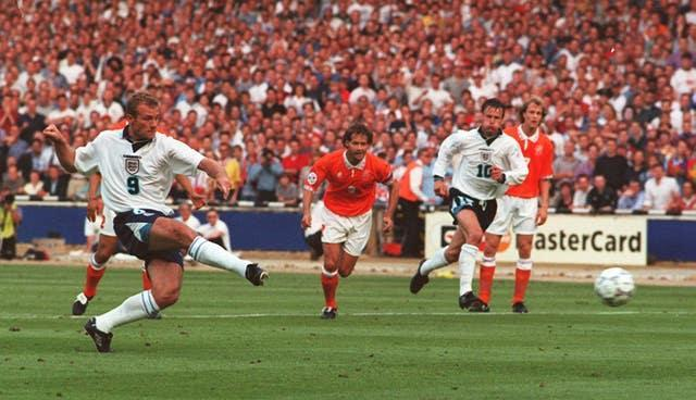 Alan Shearer scores against Holland at Euro 96