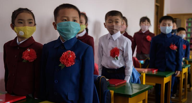 Children wearing face masks after schools in Pyongyang opened again last week. Source: Getty Images