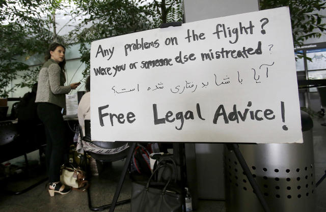 <p>A sign for attorneys and volunteers offering free legal help is placed by a protesting group at the international terminal at San Francisco International Airport in San Francisco, June 29, 2017. A scaled-back version of President Donald Trump's travel ban takes effect Thursday evening, stripped of provisions that brought protests and chaos at airports worldwide in January yet still likely to generate a new round of court fights. (AP Photo/Jeff Chiu) </p>
