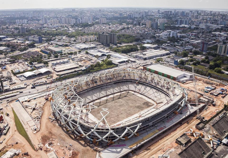 In this photo released by Portal da Copa 2014, an aerial view of the Arena da Amazonia stadium, in Manaus, Brazil, October, 2013. The draw for the 2014 World Cup finals takes place Friday Dec. 6, 2013 near Salvador, Brazil. The 32 teams will be drawn into eight groups of four. The top two in each group will progress to the knockout stages. Twelve stadiums in twelve cities will host matches.(AP Photo/Portal da Copa 2014, Jose Zamith de Oliveira Filho)