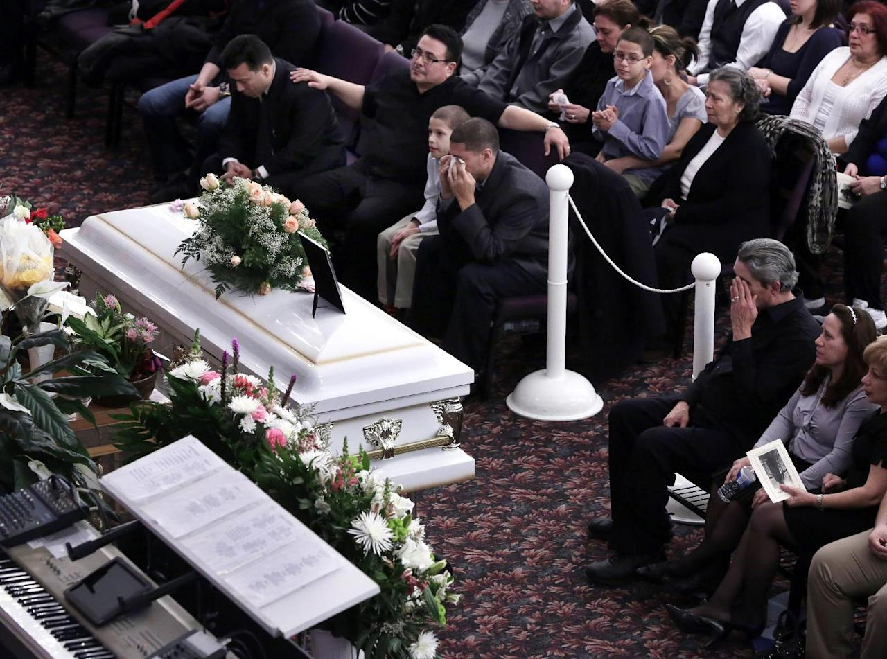 Steven Sierra, husband of Sarai Sierra, upper center, and Dennis Jimenez, right, wipe their eyes during her funeral, at the Christian Pentecostal Church, in the Staten Island borough of New York, Friday, Feb. 15, 2013. The 33-year-old mother of two was killed while vacationing alone in Turkey. Sierra disappeared Jan. 21, and her body was discovered 12 days later near Istanbul's ancient city walls. (AP Photo/Richard Drew)