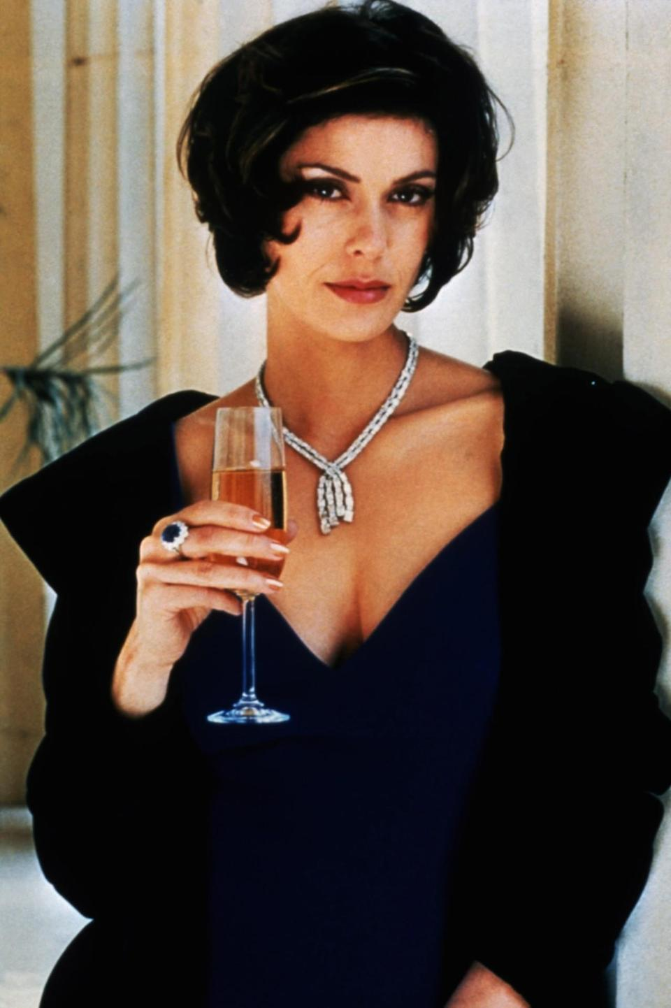 <p>As Bond's ex-girlfriend, Carver is now married to the film's villain, Elliot Carver, a media mogul who will stop at nothing — literally global war — to boost his empire. Dripping in diamonds with a chic bob, she's another unfortunate casualty who winds up in the crossfire.<i> (Photo: Everett Collection)<br></i></p>