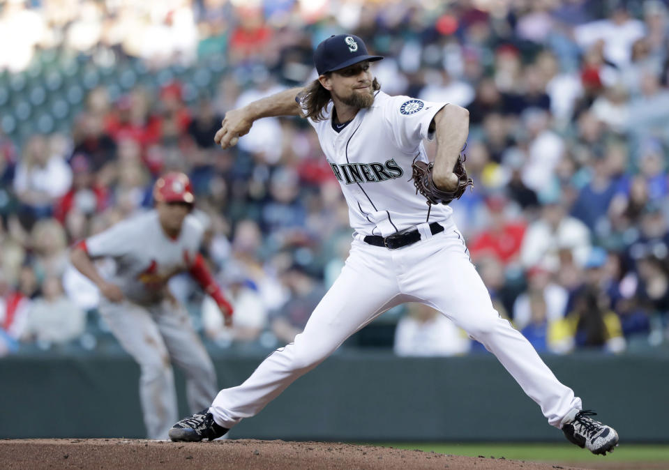 Seattle Mariners starting pitcher Mike Leake throws as St. Louis Cardinals' Yairo Munoz leads off at first base during the first inning of a baseball game Wednesday, July 3, 2019, in Seattle. (AP Photo/Elaine Thompson)