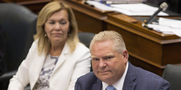 Ontario Premier Doug Ford sits next to Health Minister Christine Elliott during question period at Queen's Park in Toronto on July 31, 2018.