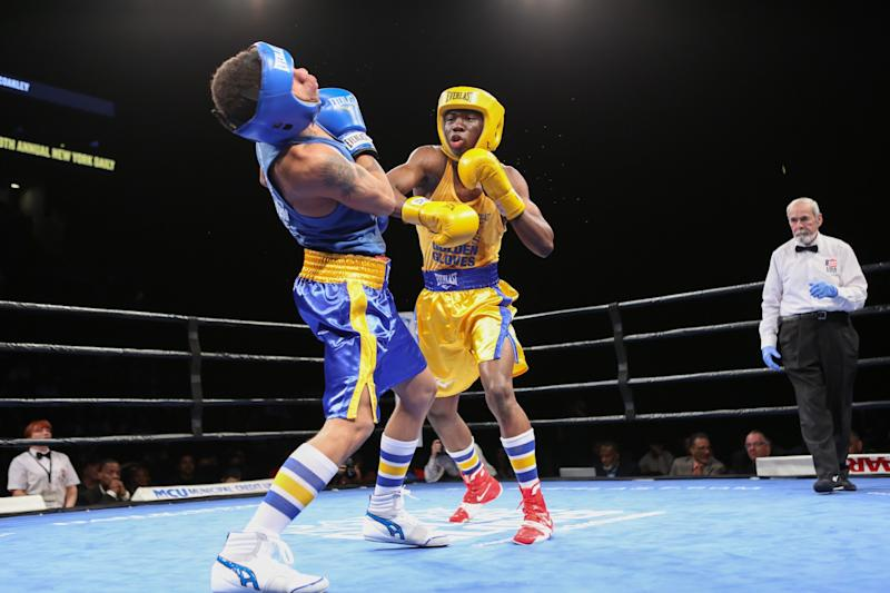 Richardson Hitchins (right) fights Christian Coakley in the N.Y. Golden Gloves tournament. (AP)