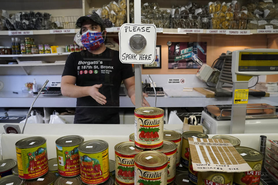 An amplifier is built into a protective plastic shield due to COVID-19 concerns at Borgatti's Ravioli & Egg Noodles, a speciality pasta shop off Arthur Avenue, a historically Italian immigrant community known for its ethnic food and products, Wednesday, March 3, 2021, in the Bronx borough of New York. (AP Photo/John Minchillo)