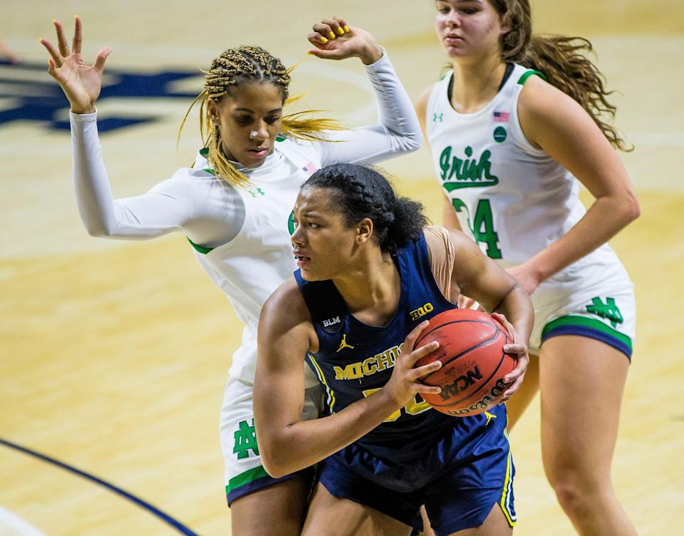 Michigan's Naz Hillmon (0) keeps the ball away from Notre Dame's Amirah Abdur-Rahim (3) on Dec. 3, 2020 at Purcell Pavilion in South Bend, Indiana.