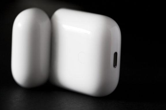 On the back of the case is a Bluetooth pairing button you can use to pair the AirPods with third-party audio devices.