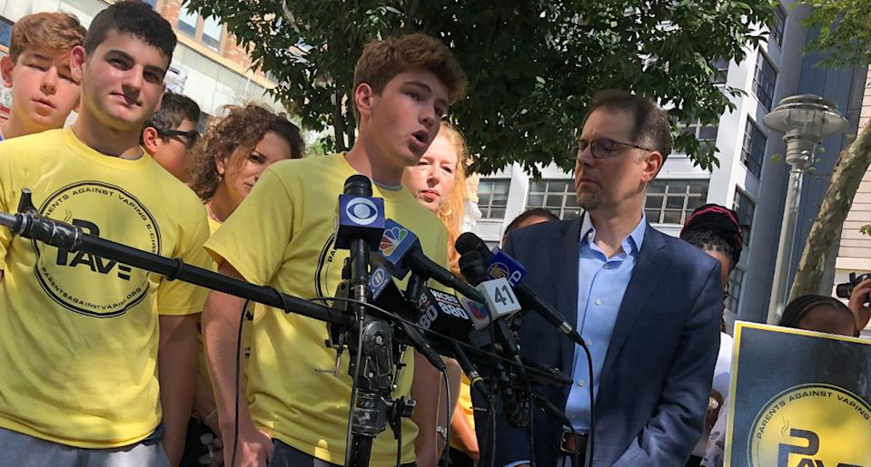 Phillip (in front of the microphones and next to New York City councilman Mark Levine) speaking at a press conference and rally in front of Juul Labs headquarters in New York. (Photo: Dorian Fuhrman)