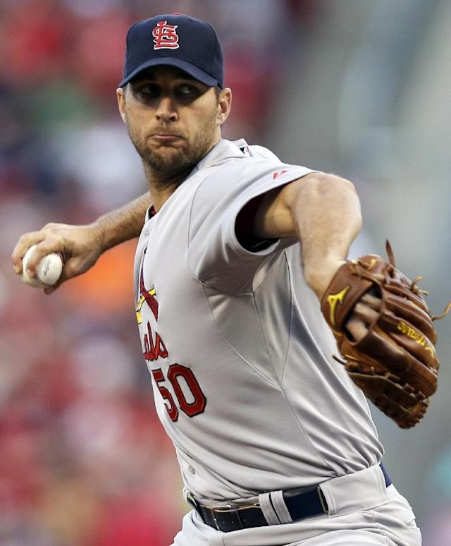 St. Louis Cardinals starting pitcher Adam Wainwright throws against the Cincinnati Reds in the first inning of a baseball game, Sunday, May 25, 2014, in Cincinnati. (AP Photo/Al Behrman)