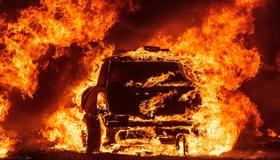 A car burning outside Vacaville, California, during the Lightning Complex fire (AFP/Getty)