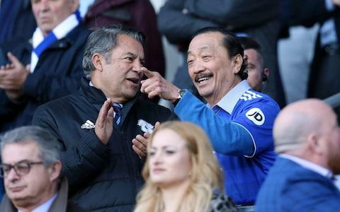 Cardiff City chairman Mehmet Dalman speaks with club owner Vincent Tan - Credit: Getty Images