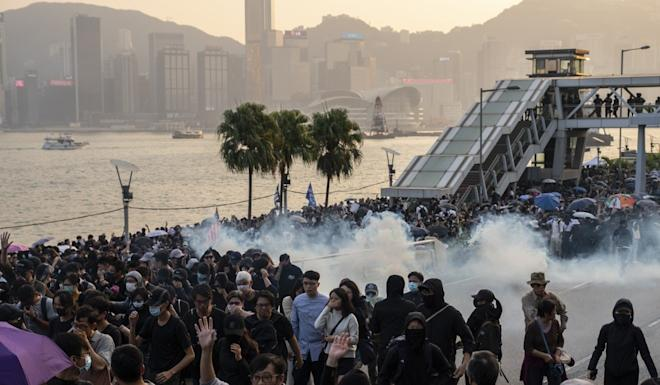 Riot police fire tear gas to deter demonstrators in Hong Kong. Photo: Bloomberg