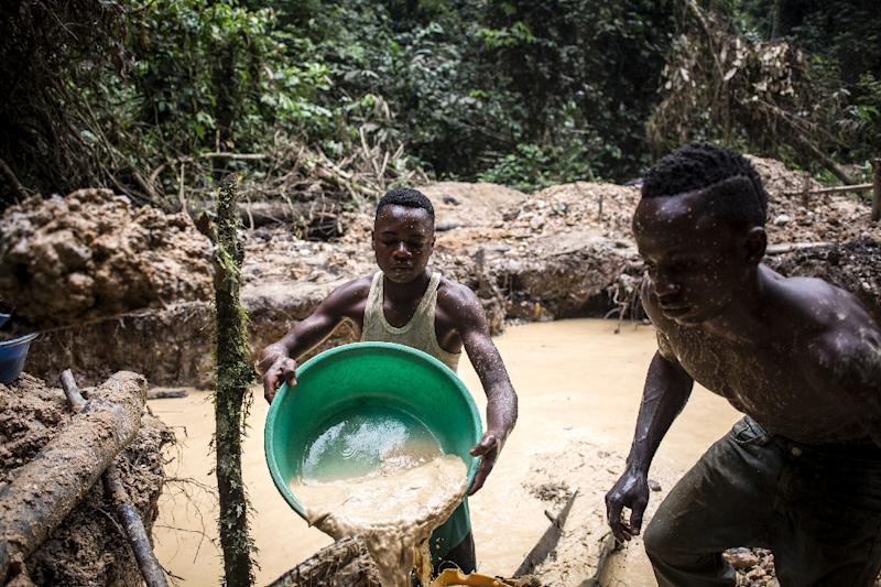 Congolese artisanal miners use water to separate soil from ore at a gold mine in Ituri province. The DRC also has abundant amounts of uranium, copper and cobalt (AFP Photo/John WESSELS)