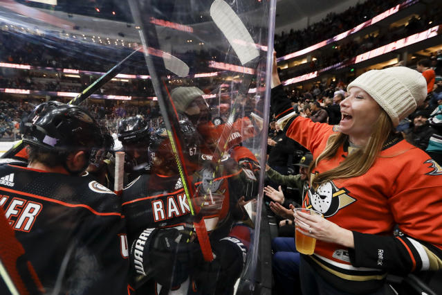 A fan celebrates after a goal by Anaheim Ducks right wing Jakob Silfverberg during the second period of an NHL hockey game against the San Jose Sharks in Anaheim, Calif., Thursday, Nov. 14, 2019. (AP Photo/Chris Carlson)