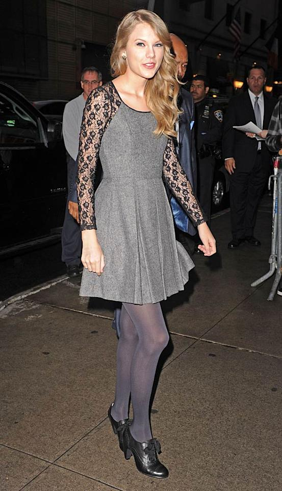 "Speaking of eyesore-inducing ensembles, check out the matronly, lace-armed miss Taylor Swift wore on ""Good Morning America."" And don't get me started on those mismatched tights and bow-adorned granny booties!  Asadorian-Mejia/Splash News - October 13, 2011"