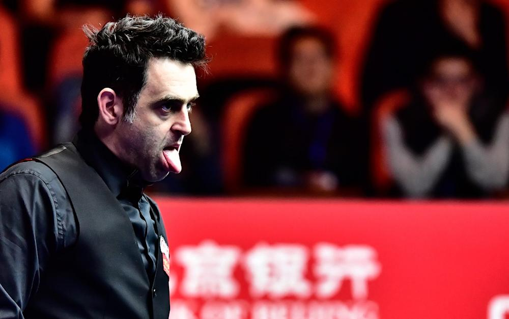 Ronnie O'Sullivan of England reacts as he misses a shot to Mark Joyce of England - Credit: Rex