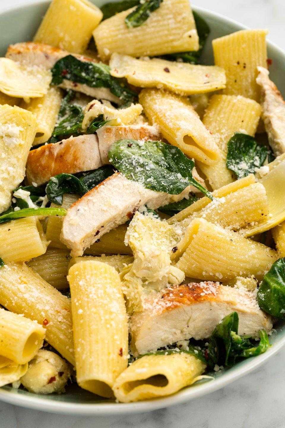 "<p>Your favorite dip deconstructed as a healthy pasta? Yes, please.</p><p>Get the recipe from <a href=""https://www.delish.com/cooking/recipe-ideas/recipes/a46527/chicken-spinach-and-artichoke-rigatoni-recipe/"" rel=""nofollow noopener"" target=""_blank"" data-ylk=""slk:Delish"" class=""link rapid-noclick-resp"">Delish</a>.</p>"