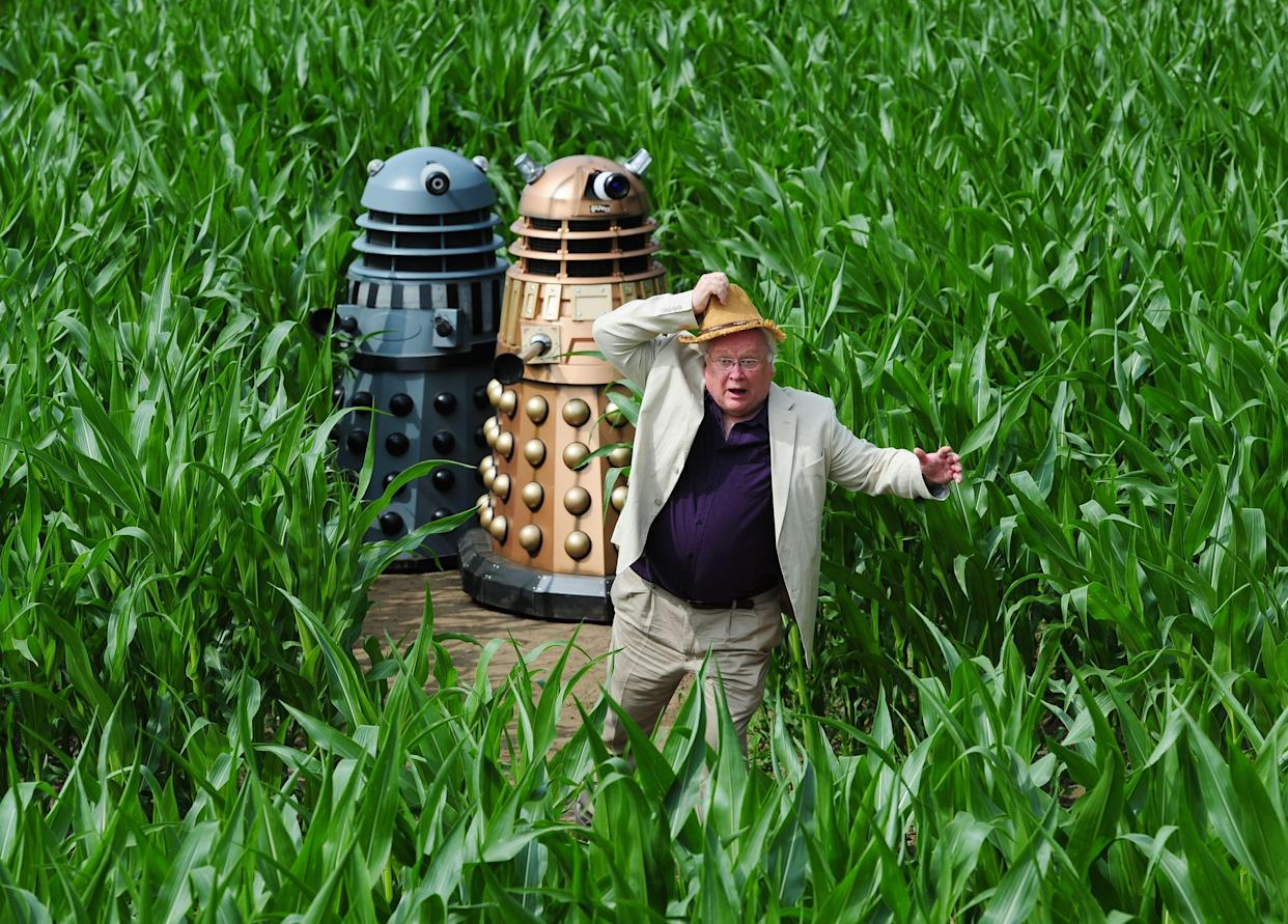 Colin Baker, the sixth Doctor, runs from the Daleks during a photocall to launch the 2013 York Maze which this year celebrates 50 years of the television series Doctor Who.   (Photo by Anna Gowthorpe/PA Images via Getty Images)