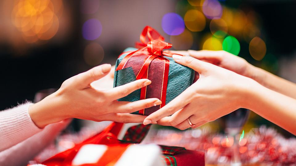 Close-up photography of two hands while giving gift.