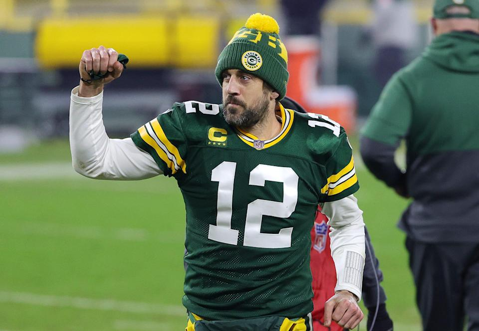 Aaron Rodgers of the Green Bay Packers celebrates defeating the Los Angeles Rams 32-18 in the NFC Divisional Playoff game at Lambeau Field on January 16, 2021 in Green Bay, Wisconsin.