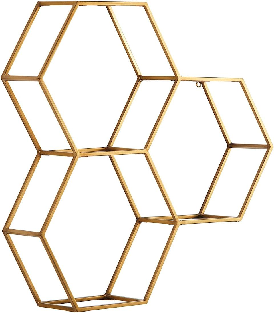 <p>These stylish <span>Rivet Modern Hexagon Honeycomb Floating Wall Shelf Unit</span> ($59) doubles as storage and decor with glass shelving. It's a modern and sleek piece that will instantly elevate and glam a space up.</p>