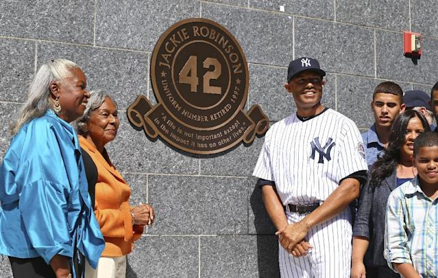 New York Yankees relief pitcher Mariano Rivera, along with his family, poses withJackie Robinson's daughter Sharon, far left, and wife Rachel after the unveiling of Robinson's monument in Monument Park during a pregame ceremony at Yankees Stadium before the Yankees baseball game against the San Francisco Giants, Sunday, Sept. 22, 2013, in New York. (AP Photo/Elsa Garrison, Pool)