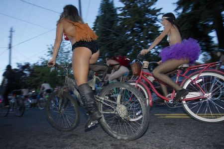 Cyclists pour into the streets of Portland for the 11th annual World Naked Bike Ride