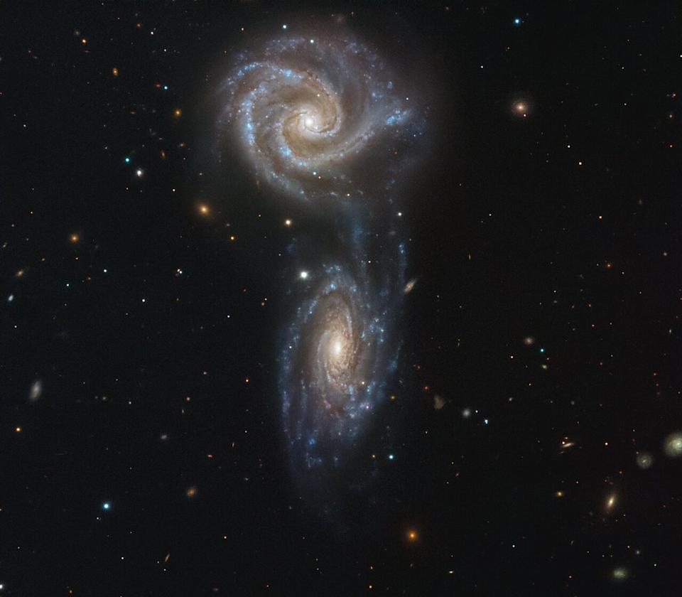 Two spiral galaxies collectively known as Arp 271 look like they're getting ready to collide. The two interacting galaxies, NGC 5426 and NGC 5427, have formed a bridge of material where new stars are beginning to form. If the galaxies do end up crashing into each other, the collision will trigger a wave of new star formation over the next few million years, according to the European Southern Observatory (ESO). This same type of interaction may happen to our own Milky Way galaxy when it collides with the Andromeda galaxy in the next five billion years or so, ESO said.
