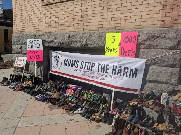 Moms Stop the Harm placed shoes in front of Rossland's city hall on Wednesday to commemorate those who have lost their lives to toxic drugs and overdoses.  (Submitted by Diana Daghofer - image credit)