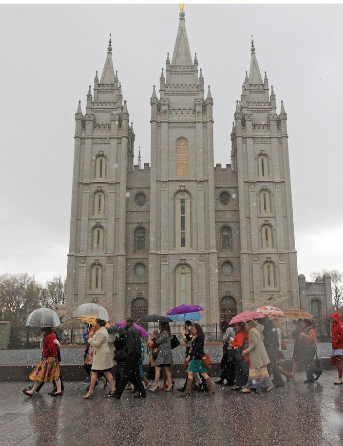 A Mormon's women group pushing the church to allow women in the priesthood march to Temple Square during the two-day Mormon church conference Saturday, April 5, 2014, in Salt lake City. The church has asked them to reconsider, and barred media from going on church property during the demonstration. Mormon officials allowed the women's group to demonstrate its displeasure for not being allowed in an all-male meeting, on church property but still didn't let them attend. (AP Photo/Rick Bowmer)