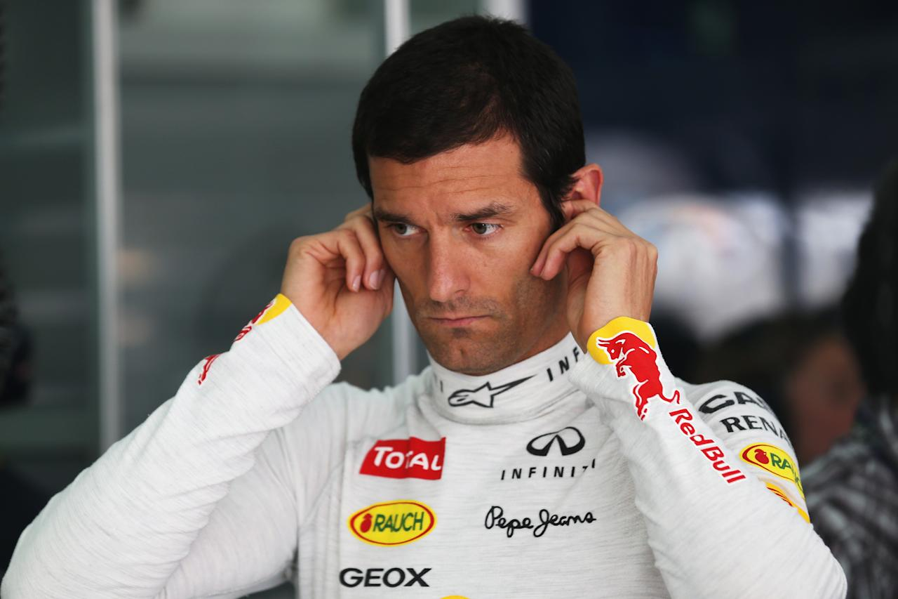 SAKHIR, BAHRAIN - APRIL 20:  Mark Webber of Australia and Infiniti Red Bull Racing prepares to drive during qualifying for the Bahrain Formula One Grand Prix at the Bahrain International Circuit on April 20, 2013 in Sakhir, Bahrain.  (Photo by Mark Thompson/Getty Images)