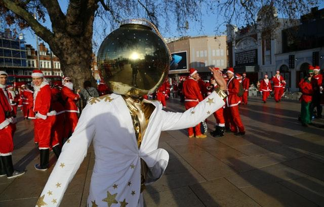 Man dressed as Christmas bauble