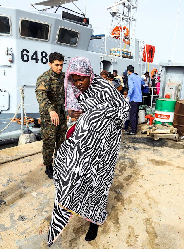<p>African migrants rescued from a ship off the coast of Zawiyah, about 45 kilometres west of the Libyan capital Tripoli, disembark at the dock at the capital's naval base on March 10, 2018. (Photo: Mahmud Turkia/AFP/Getty Images) </p>