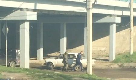 A still image from a video footage taken on April 6, 2018 shows a Russian serviceman checking a car heading to the Defence Ministry base in Molkino near Krasnodar, Russia. REUTERS/Stringer